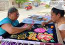 Artesanos de Santa Rosa de Lima en Oaxaca siguen bordando trajes regionales,la pandemia no afectó su trabajo
